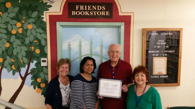 Shown with Award Certificate in front of the newly remodeled Friends of A.K. Smiley Bookstore (from left): Friends Volunteers Rita Reading, Radha Shah, Ted Parsons, Sue Remes